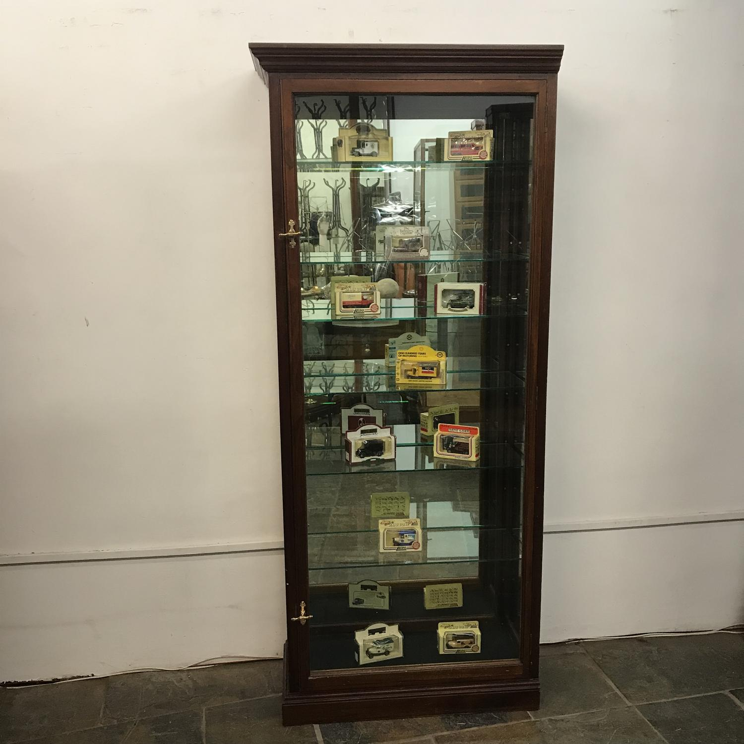 Thin mahogany shop cabinet with mirror back