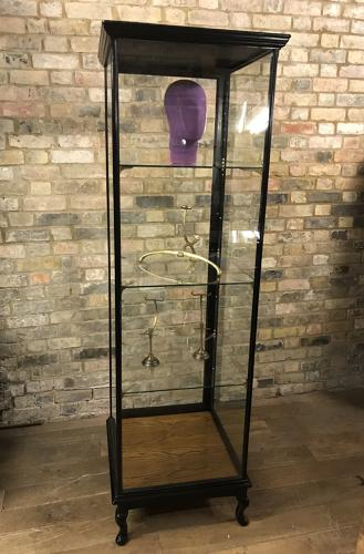 1920s black  tall shop display cabinet