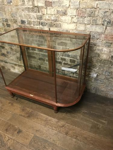Antique mahogany bow shop counter