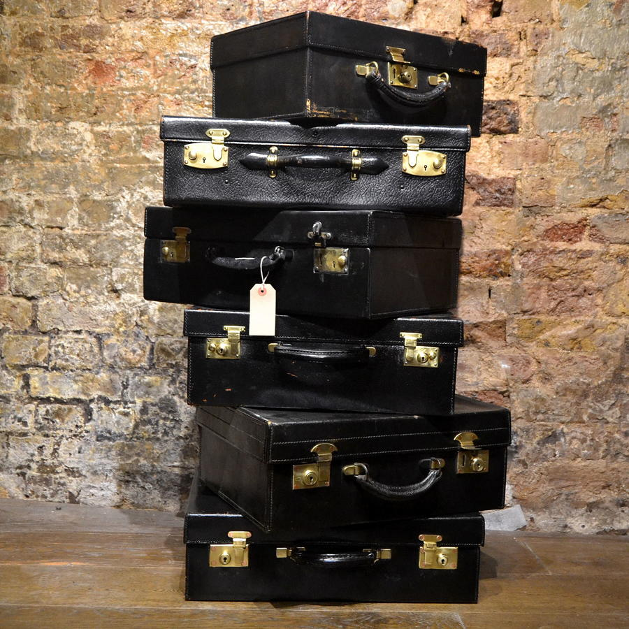 Various Black Leather Suitcases