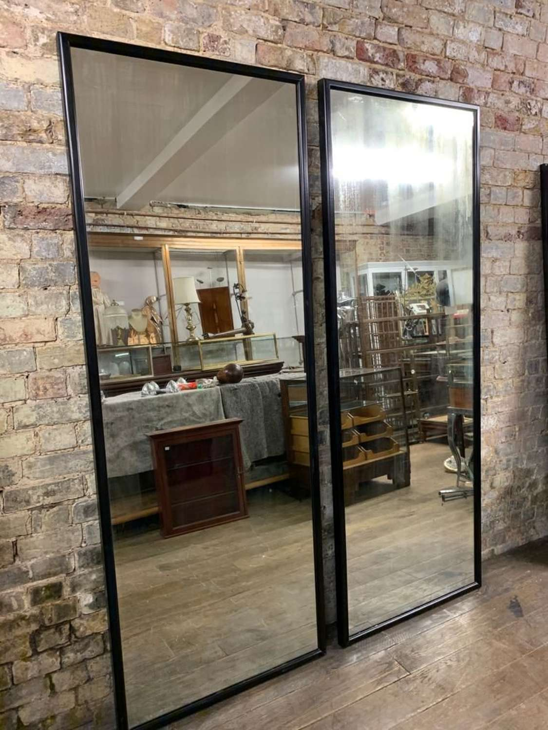 Pair of polished black shop Mirrors